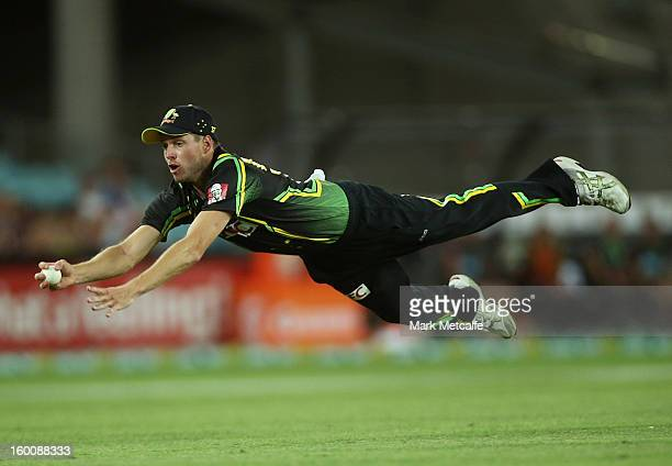 Ben Laughlin of Australia dives to take a catch and dismiss Tillakaratne Dilshan of Sri Lanka during game one of the Twenty20 international match...