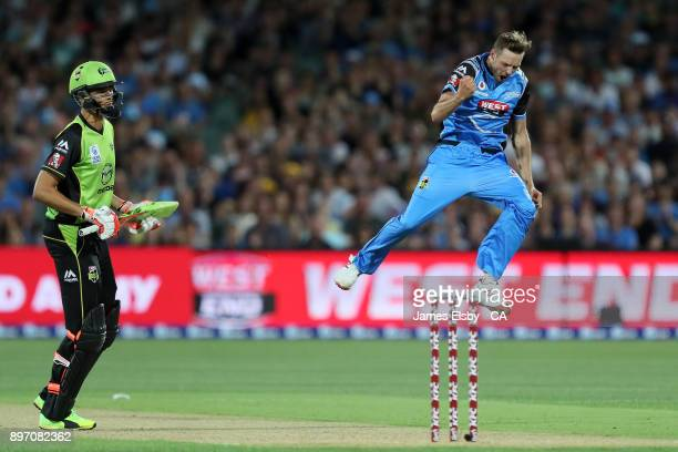 Ben Laughlin of the Adelaide Strikers celebrates the wicket of Chris Green of the Sydney Thunder during the Big Bash League match between the...