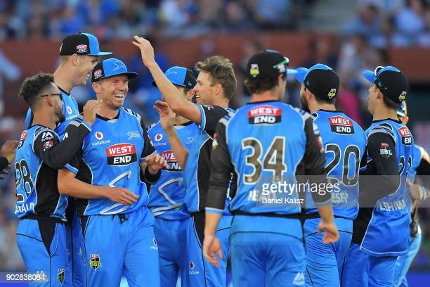 Ben Laughlin of the Adelaide Strikers celebrates with his team mates after Alex Carey of the Adelaide Strikers takes a catch to dismiss Peter...
