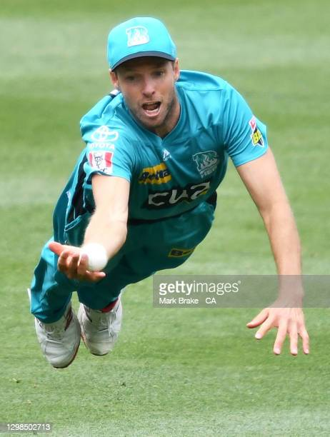 Ben Laughlin of the Heat gets a hand to a catch but drops it during the Big Bash League match between the Brisbane Heat and Perth Scorchers at...