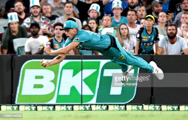 Ben Laughlin of the Heat takes a catch to dismiss Michael Neser of the Strikers during the Big Bash League Eliminator Final match between the...