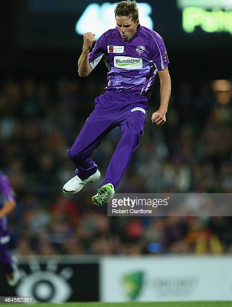 Ben Laughlin of the Hurricanes celebrates after he took the wicket of Luke Pomersbach of the Heat during the Big Bash League match between the Hobart...