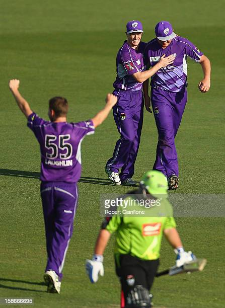 Ben Laughlin of the Hurricanes celebrates the wicket of Mark Cosgrove of the Thunder caught by Doug Bollinger during the Big Bash League match...