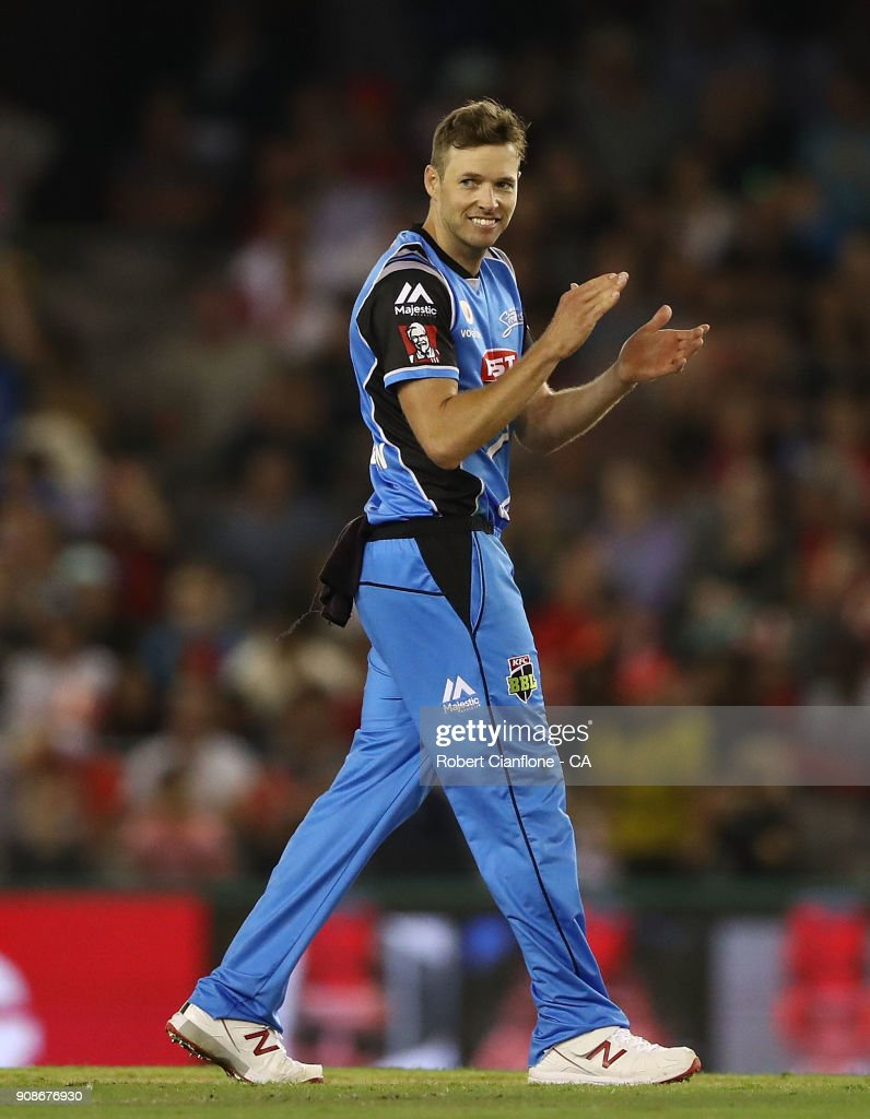 Ben Laughlin of the Strikers celebrates the wicket of Keiron Pollard of the Renegades during the Big Bash League match between the Melbourne Renegades and the Adelaide Strikers at Etihad Stadium on January 22, 2018 in Melbourne, Australia.