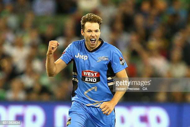 Ben Laughlin of the Strikers celebrates the wicket of Rob Quiney of the Stars during the Big Bash League match between the Melbourne Stars and the...