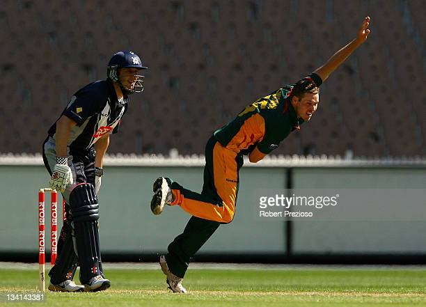 Ben Laughlin of the Tigers bowls during the Ryobi One Day Cup match between the Victoria Bushrangers and the Tasmania Tigers at Melbourne Cricket...