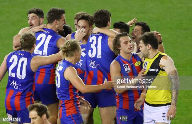 Ben Lennon of Richmond is consoled by Ashley Krakauer of Port Melbourne as Lennon reacts after missing a kick after the siren as Port Melbourne...