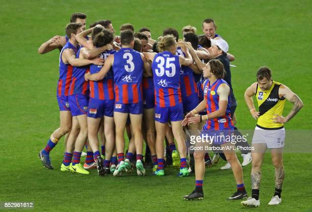 Ben Lennon of Richmond reacts after missing a kick after the siren as Port Melbourne players celebrate winning during the VFL Grand Final match...