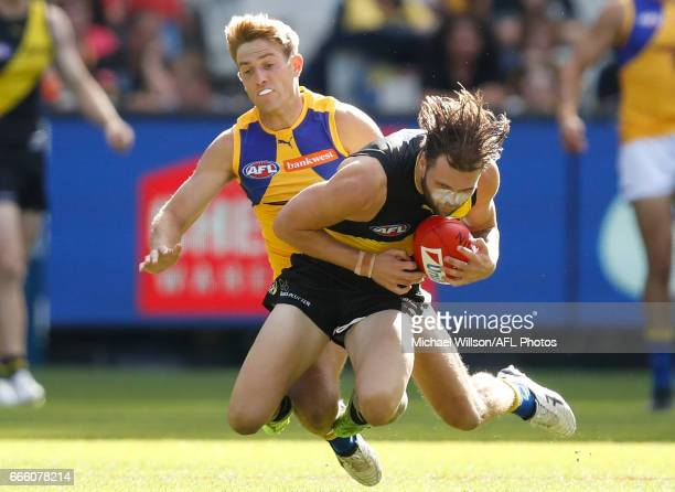 Ben Lennon of the Tigers marks the ball ahead of Brad Sheppard of the Eagles during the 2017 AFL round 03 match between the Richmond Tigers and the...