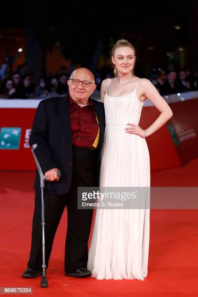 Ben Lewin and Dakota Fanning walk a red carpet for 'Please Stand By' during the 12th Rome Film Fest at Auditorium Parco Della Musica on October 31,...
