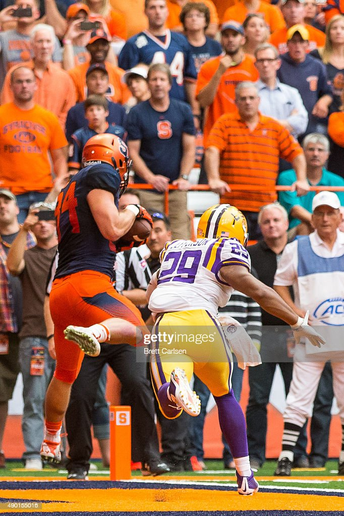 Ben Lewis #84 of the Syracuse Orange catches a touchdown reception as Rickey Jefferson #29 of the LSU Tigers defends making the score LSU 24 - Syracuse 17 during the fourth quarter on September 26, 2015 at The Carrier Dome in Syracuse, New York. LSU defeats Syracuse 34-24.