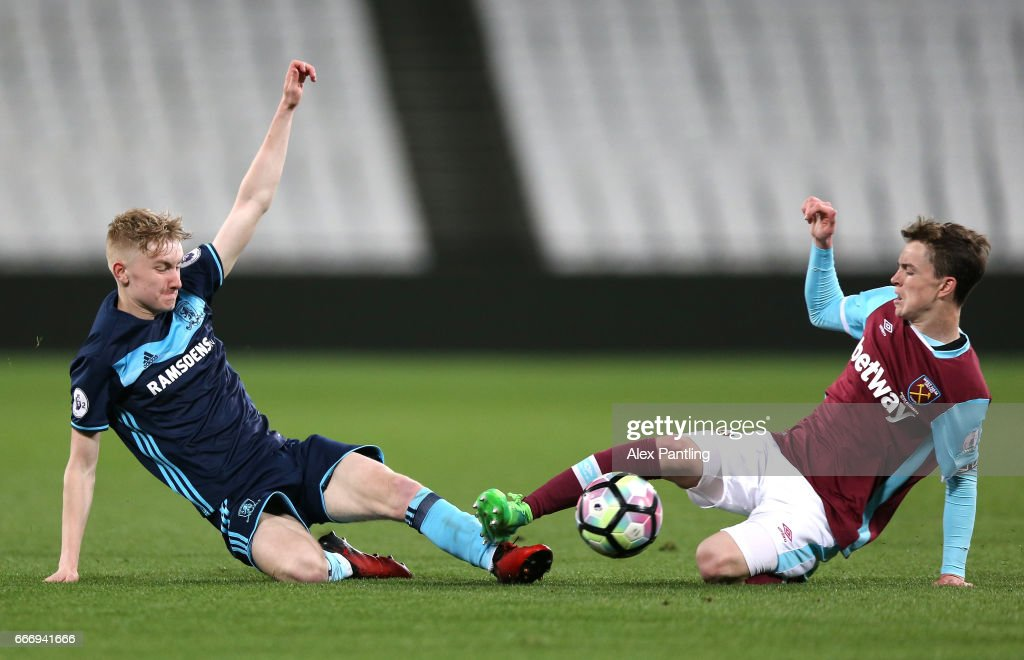 Ben Liddle of Middlesbrough and Alfie Lewis of West Ham United clash during the Premier League 2 match between West Ham United and Middlesbrough at London Stadium on April 10, 2017 in Stratford, England.