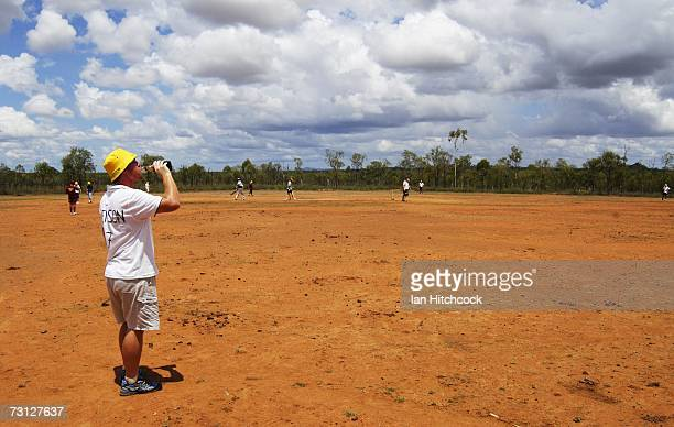 Ben Littlefield drinks a beer whilst fielding at a ground called 'Drinkastubbie Downs' during the Goldfield Ashes January 26 2007 in Charters Towers...