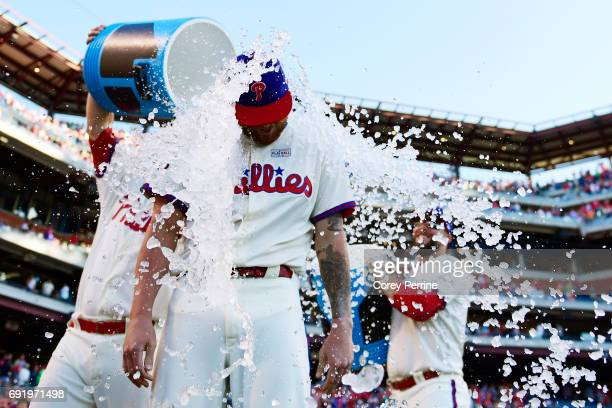 Ben Lively is doused after the game by Tommy Joseph and Cameron Rupp of the Philadelphia Phillies for his performance against the San Francisco...