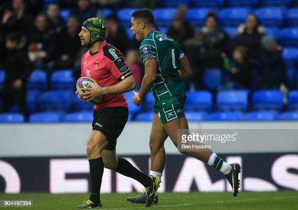 Ben Loader of London Irish celebrates after scoring his team's first try of the game during the European Rugby Challenge Cup between London Irish and...