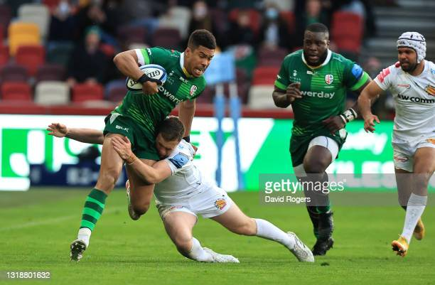 Ben Loader of London Irish is held by Joe Simmonds during the Gallagher Premiership Rugby match between London Irish and Exeter Chiefs at Brentford...