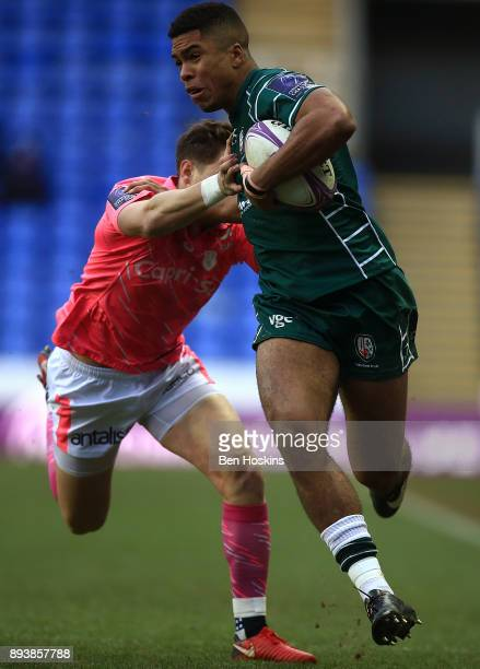 Ben Loader of London Irish is tackled by Clement Daguin of Stade Francais during the European Rugby Challenge Cup match between London Irish and...