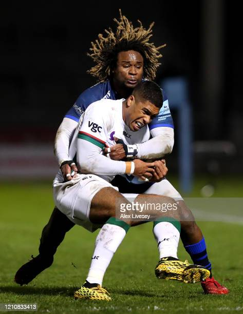 Ben Loader of London Irish is tackled by Marland Yarde of Sale Sharks during the Gallagher Premiership Rugby match between Sale Sharks and London...