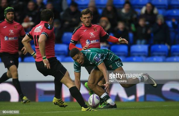 Ben Loader of London Irish picks up the ball on his way to scoring his team's first try of the game during the European Rugby Challenge Cup between...