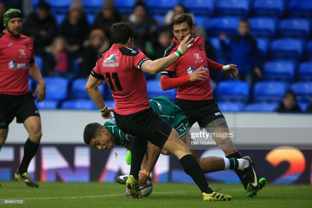 Ben Loader of London Irish picks up the ball on his way to scoring his team's first try of the game during the European Rugby Challenge Cup between London Irish and Krasny Yar on January 13, 2018 in Reading, United Kingdom.
