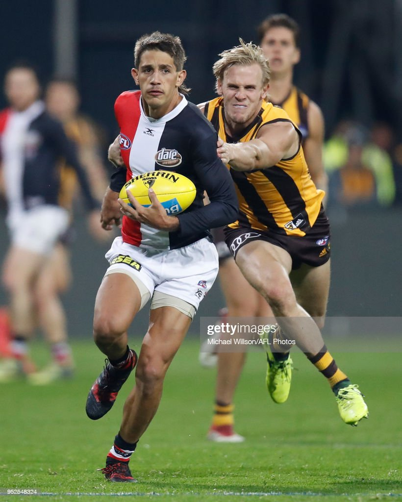 Ben Long of the Saints is tackled by Will Langford of the Hawks during the 2018 AFL round six match between the Hawthorn Hawks and the St Kilda Saints at UTAS Stadium on April 28, 2018 in Launceston, Australia.