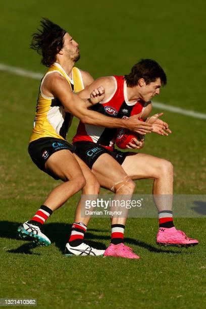 Ben Long tackles Jack Steele of the Saints during a St Kilda Saints AFL training session at RSEA Park on June 03, 2021 in Melbourne, Australia.