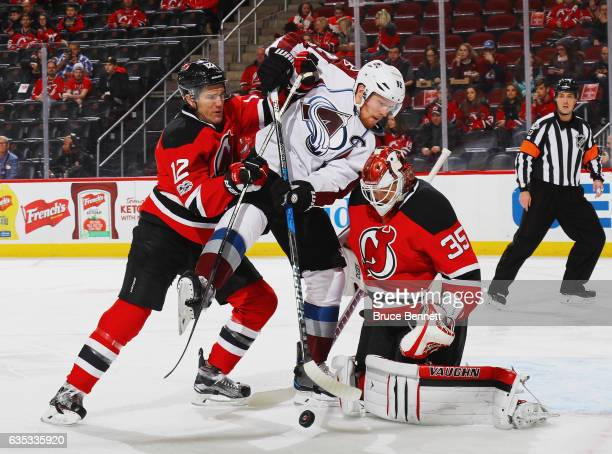 Ben Lovejoy and Cory Schneider of the New Jersey Devils defend against Gabriel Landeskog of the Colorado Avalanche during the first period at the...