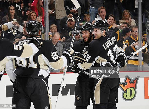 Ben Lovejoy celebrates his goal with Kris Letang and Phil Kessel of the Pittsburgh Penguins during the third period against the St Louis Blues at...