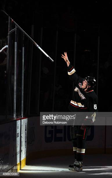 Ben Lovejoy of the Anaheim Ducks hands his stick to a fan after the game against the Edmonton Oilers on December 15 2013 at Honda Center in Anaheim...
