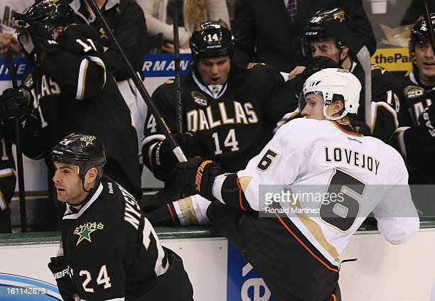 Ben Lovejoy of the Anaheim Ducks is checked into the Stars bench by Eric Nystrom of the Dallas Stars at American Airlines Center on February 8 2013...