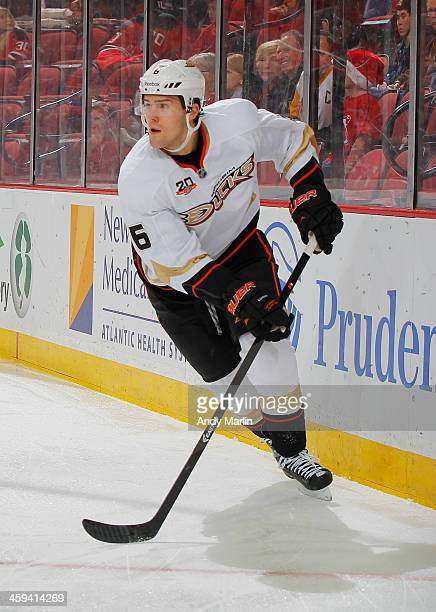 Ben Lovejoy of the Anaheim Ducks plays the puck against the New Jersey Devils during the game at the Prudential Center on December 20 2013 in Newark...