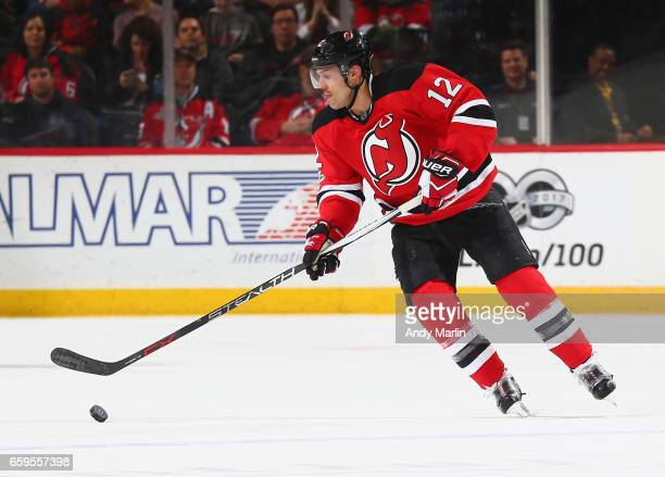 Ben Lovejoy of the New Jersey Devils controls the puck against the Carolina Hurricanes during the game at Prudential Center on March 25 2017 in...