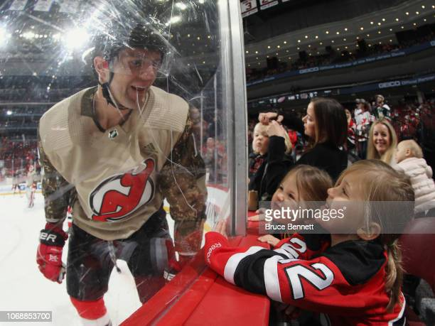 Ben Lovejoy of the New Jersey Devils says hello to his children June and Lila during warmups prior to the game against the Detroit Red Wings at the...