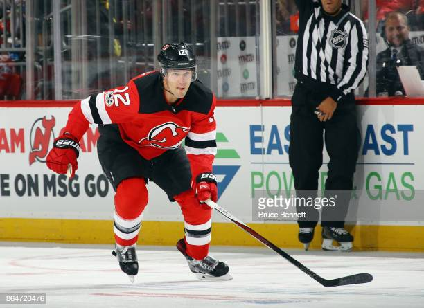 Ben Lovejoy of the New Jersey Devils skates against the San Jose Sharks at the Prudential Center on October 20 2017 in Newark New Jersey The Sharks...