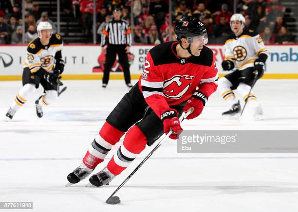Ben Lovejoy of the New Jersey Devils takes the puck in the first period against the Boston Bruins on November 22 2017 at Prudential Center in Newark...