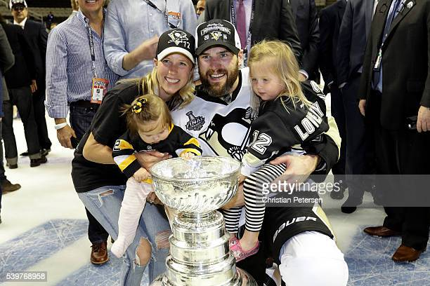 Ben Lovejoy of the Pittsburgh Penguins celebrates with his family after the Penguins 31 victory to win the Stanley Cup against the San Jose Sharks in...