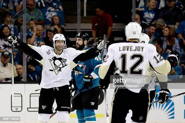 Ben Lovejoy of the Pittsburgh Penguins celebrates with Matt Cullen after scoring in the first period against the San Jose Sharks in Game Three of the...