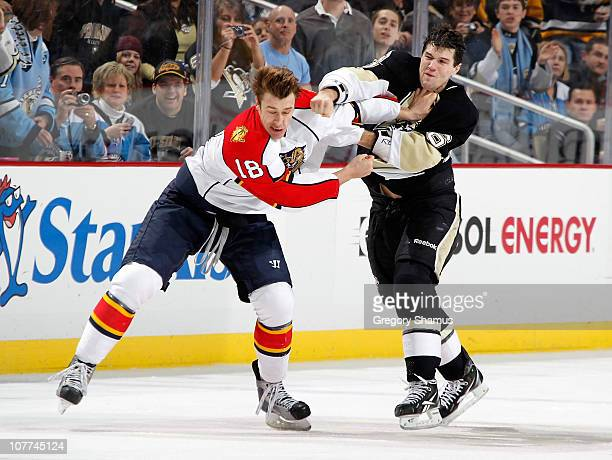 Ben Lovejoy of the Pittsburgh Penguins lands a punch on Shawn Mathias of the Florida Panthers on December 22 2010 at Consol Energy Center in...