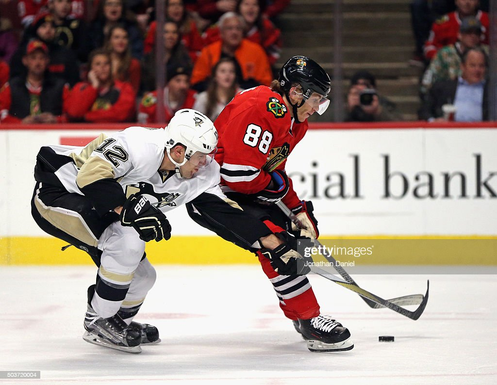 Ben Lovejoy #12 of the Pittsburgh Penguins pressures Patrick Kane #88 of the Chicago Blackhawks at the United Center on January 6, 2016 in Chicago, Illinois.