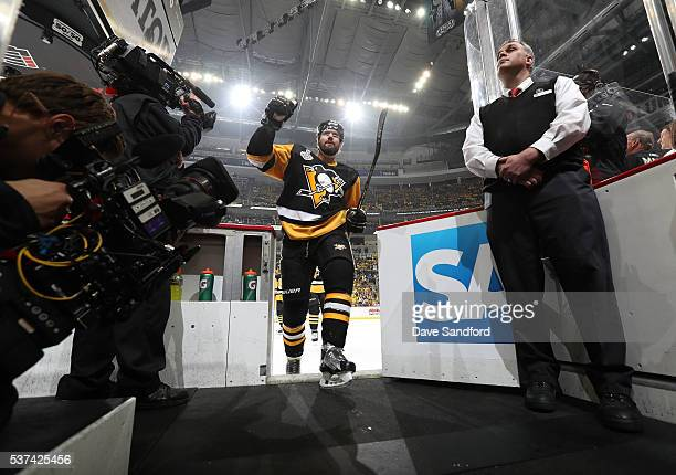 Ben Lovejoy of the Pittsburgh Penguins waves to the stands as he leaves the ice after warmup prior to Game Two of the 2016 NHL Stanley Cup Final...