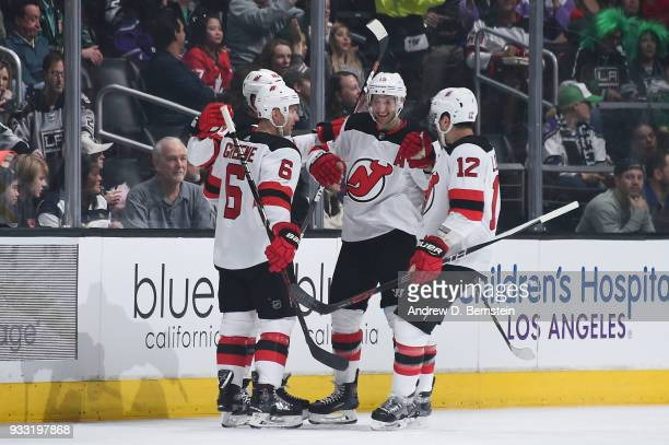 Ben Lovejoy Travis Zajac Michael Grabner and Andy Greene of the New Jersey Devils celebrate after scoring a goal against the Los Angeles Kings at...