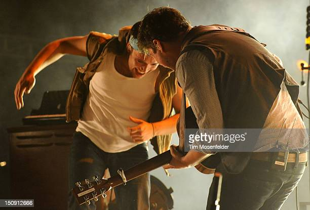 Ben Lovett and Marcus Mumford of Mumford Sons perform in advance of the bands' Babel release at Red Rocks Amphitheatre on August 28 2012 in Morrison...