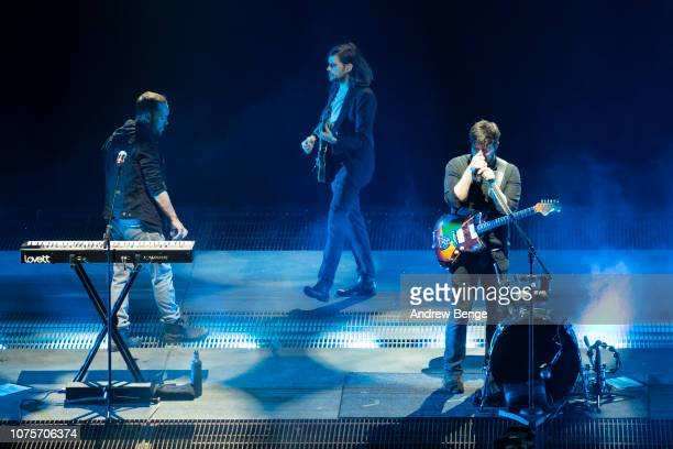 Ben Lovett Marcus Mumford and Winston Marshall of Mumford Sons perform at First Direct Arena on December 01 2018 in Leeds England
