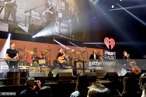 Ben Lovett Marcus Mumford Winston Marshall and Ted Dwane of Mumford Sons perform onstage during iHeartRadio ALTer Ego 2018 at The Forum on January 19...