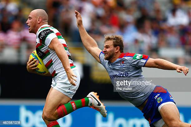 Ben Lowe of the Rabbitohs is tackled by Nathan Ross of the Knights during the match between the Knights and the Rabbitohs in the 2015 Auckland Nines...