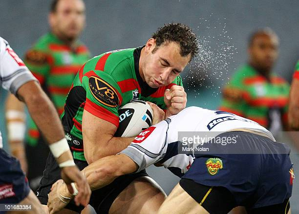 Ben Lowe of the Rabbitohs is tackled during the round 13 NRL match between the South Sydney Rabbitohs and the North Queensland Cowboys at ANZ Stadium...