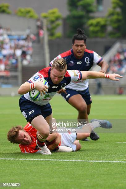 Ben Lucas of the Reds grounds the ball to score his side's second try during the Super Rugby match between Sunwolves and Reds at Prince Chichibu...