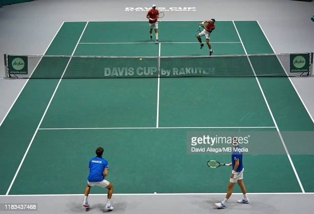 Ben MachLachlan and Yasutaka Uchiyama of Japan in action during their double match against Nicolas Mahut and Pierre Hugue Herbert of France during...