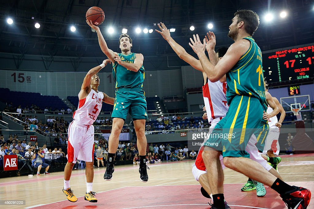 Ben Madgen (C) of Australia drives to the basket against Guo Ailun of China during the 2014 Sino-Australia Men's International Basketball Challenge match between the Australian Boomers and China at Liyang City Stadium on June 8, 2014 in Changzhou, China.