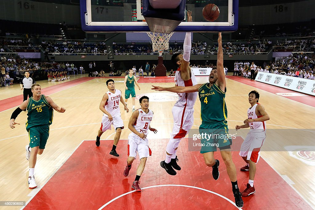 Ben Madgen (R) of Australia drives to the basket against Xu Zhonghao of China during the 2014 Sino-Australia Men's International Basketball Challenge match between the Australian Boomers and China at Liyang City Stadium on June 8, 2014 in Changzhou, China.